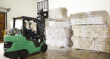Forklift with bales of shredded paper