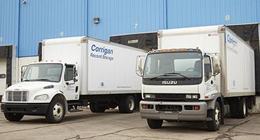Parked Corrigan Records Trucks